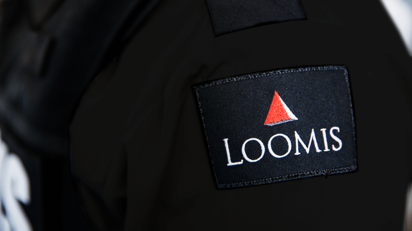 Close up of Loomis logo on shirt
