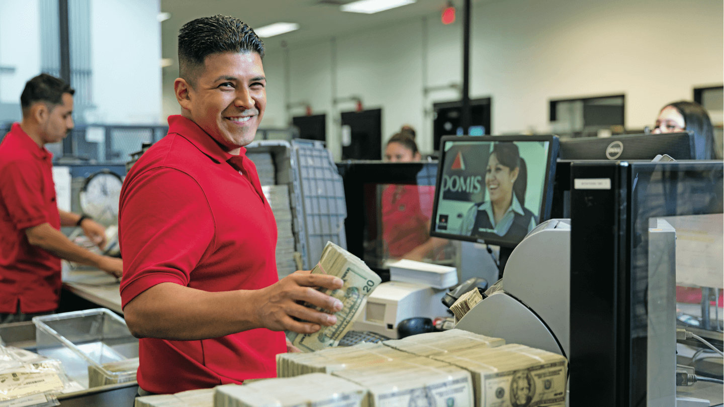 Loomis employee processing cash